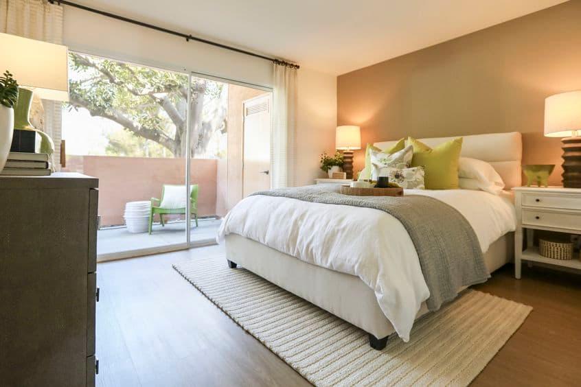 Interior view of bedroom at Newport North Apartment Homes in Newport Beach, CA.
