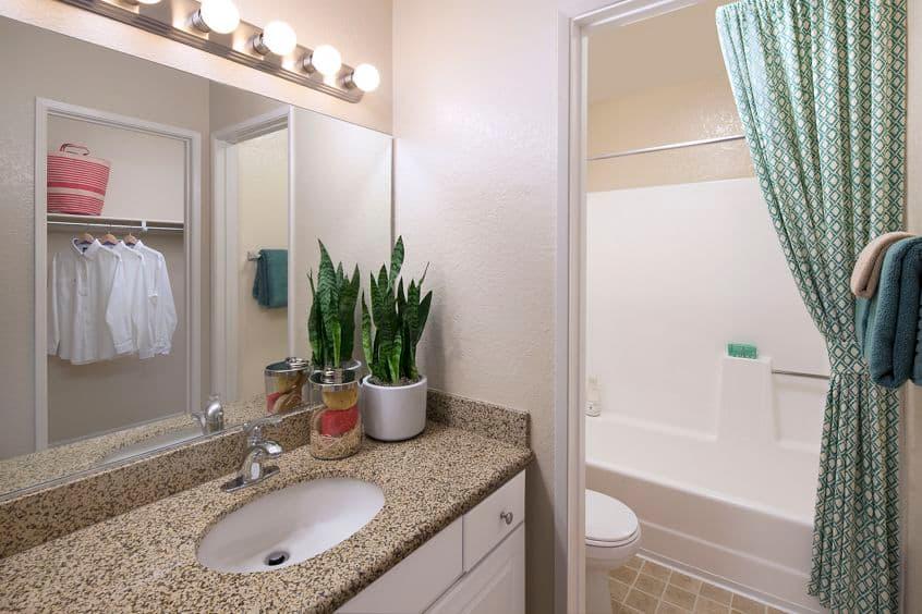 Interior view of a bathroom at Newport North Apartment Homes in Newport Beach, CA.