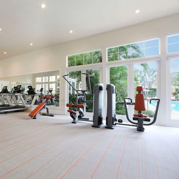 Interior view of fitness center at Newport Ridge Apartment Homes in Newport Beach, CA.