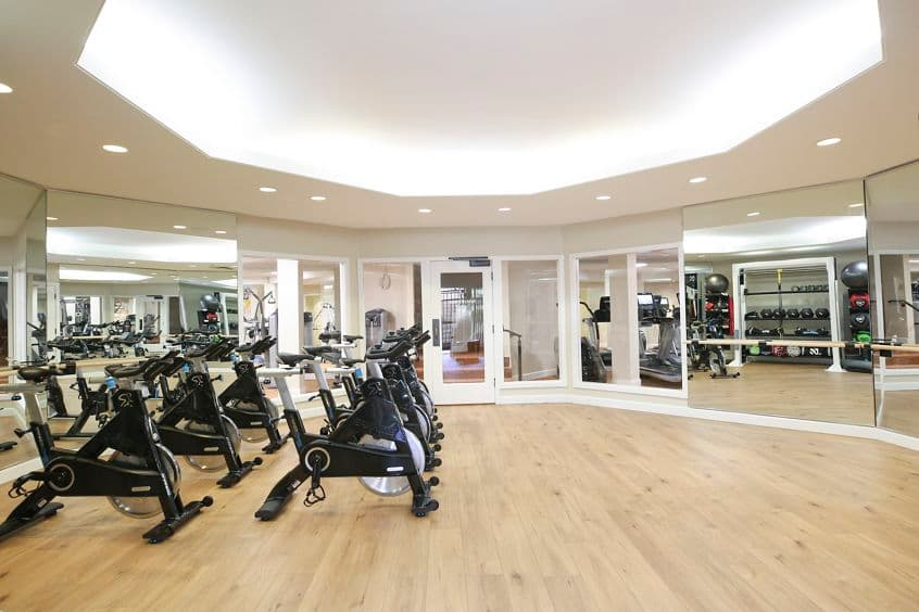 Interior view of fitness center at Promontory Point Apartment Communities in Newport Beach, CA.