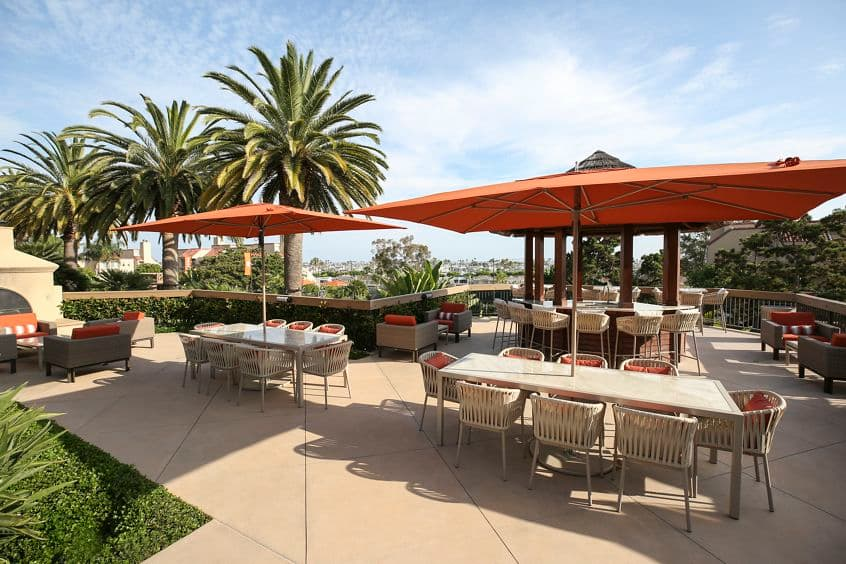 Exterior view of outdoor seating area at Promontory Point Apartment Communities in Newport Beach, CA.