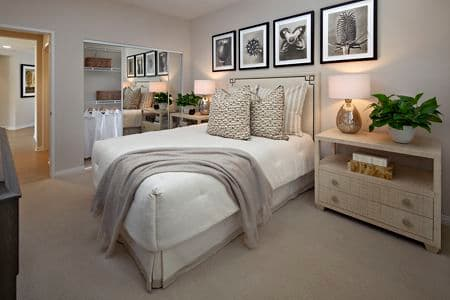 Interior view of bedroom at The Colony at Fashion Island in Newport Beach, CA.