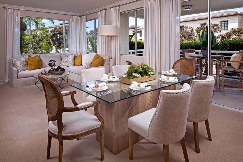 Interior view of dining room and living room at The Colony at Fashion Island Apartment Homes in Newport Beach, CA.