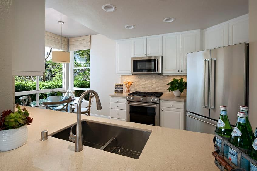 Interior view of kitchen at The Colony at Fashion Island Apartment Homes in Newport Beach, CA.