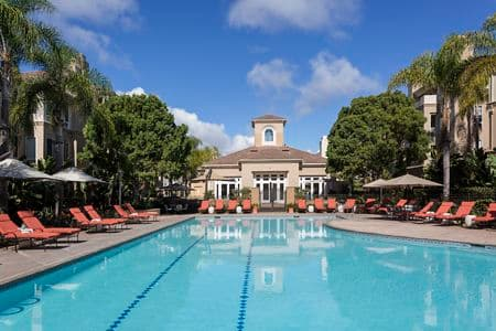 View of building exterior and pool at The Colony at Fashion Island Apartment Homes in Newport Beach, CA.