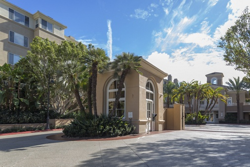 Exterior view of entrance at The Colony at Fashion Island Apartment Homes in Newport Beach, CA.