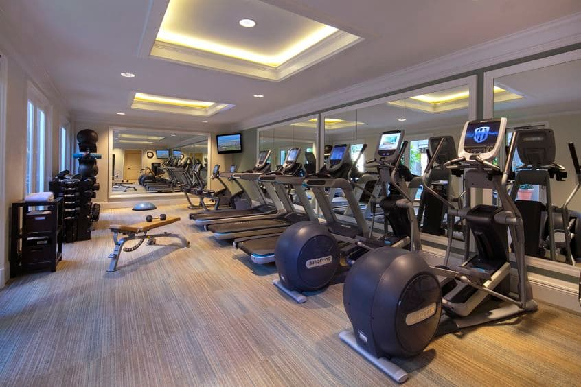 Interior view of fitness center at The Colony at Fashion Island Apartment Homes in Newport Beach, CA.