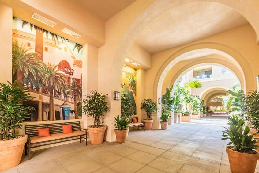 Exterior view of courtyard breezeway at The Colony at Fashion Island Apartment Homes in Newport Beach, CA.