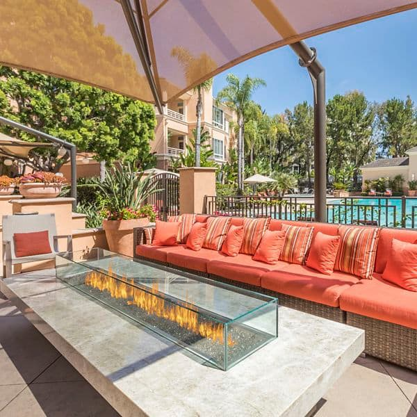 Exterior view of patio with fire pit at The Colony at Fashion Island Hotel in Newport Beach, CA.
