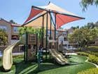 Exterior view of playground at Turtle Ridge Apartment Homes in Newport Beach, CA.