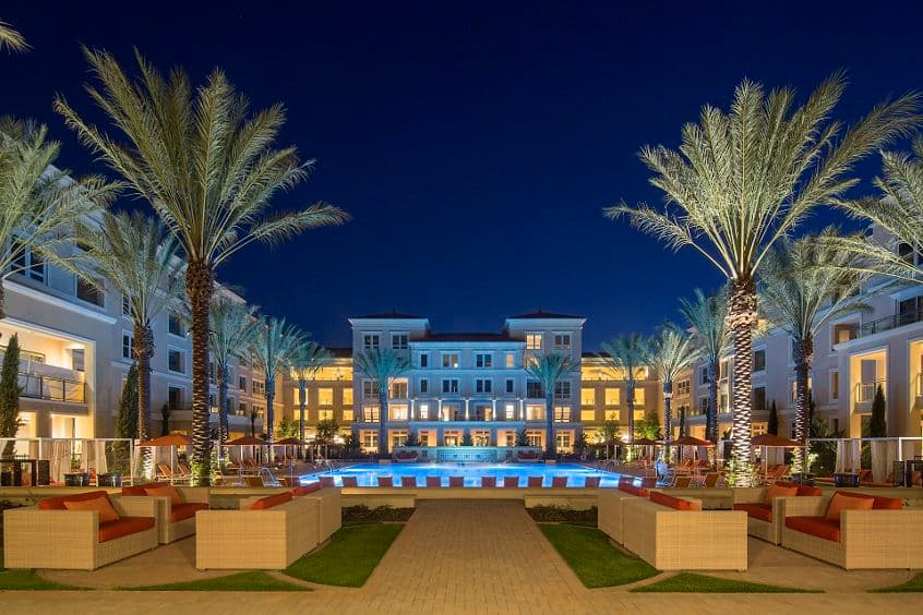 Evening view of exterior at Villas Fashion Island Apartment Homes in Newport Beach, CA.