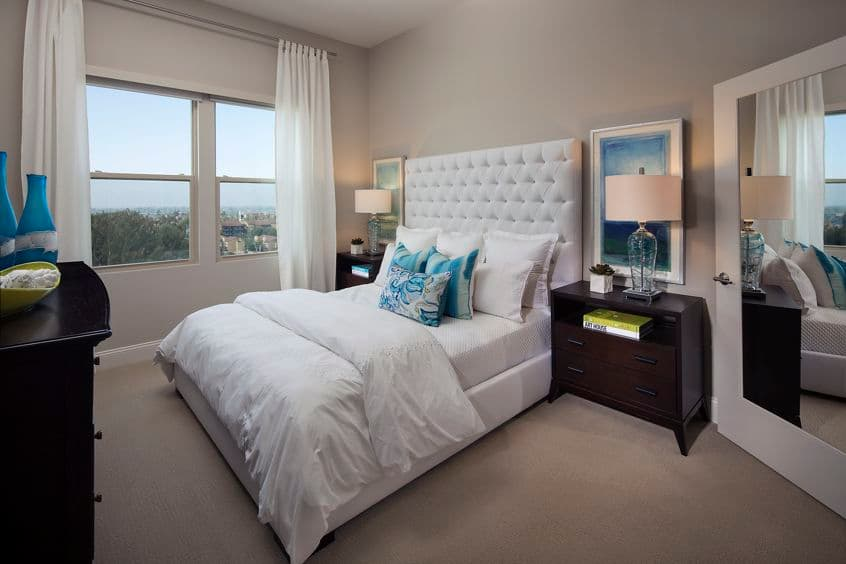 Interior view of bedroom at Villas Fashion Island Apartment Homes in Newport Beach, CA.