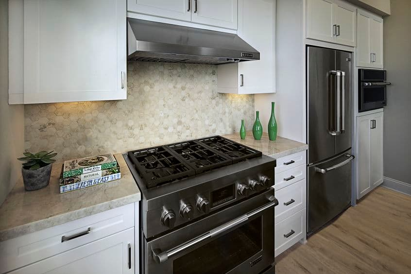 View of kitchen at Villas Fashion Island Apartment Homes in Newport Beach, CA.