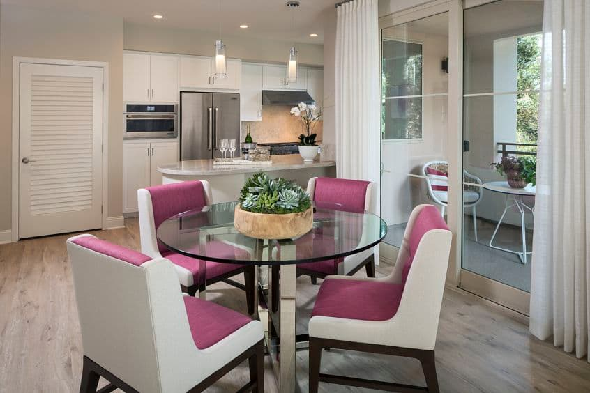 View of dining room, kitchen, and patio at Villas Fashion Island Apartment Homes in Newport Beach, CA.