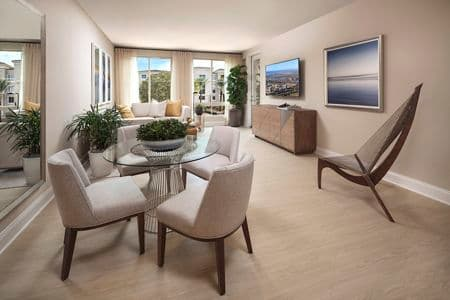 Interior view of dining and living room at Villas Fashion Island Apartment Homes in Newport Beach, CA.