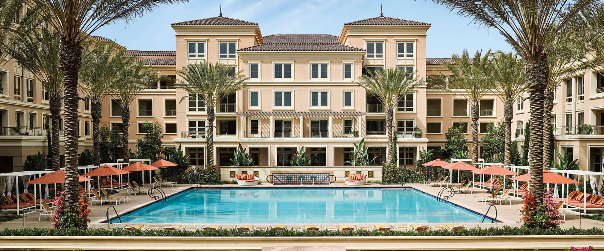 Pool view of Villas Fashion Island Apartment Homes in Newport Beach, CA.
