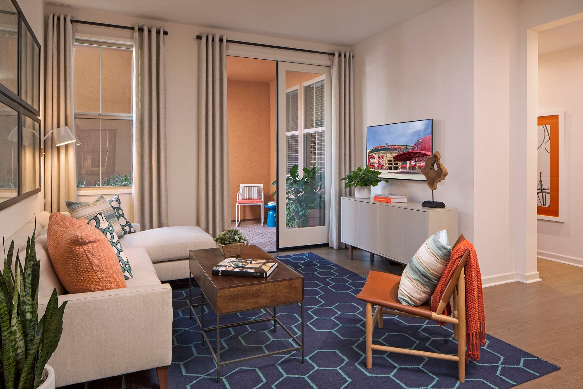 Interior views of living room and patio at Gateway Apartment Homes in Orange, CA.