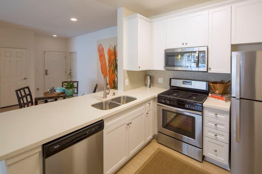 Interior view of a kitchen at Las Flores Apartment Homes in Rancho Santa Margarita, CA.