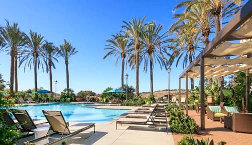 Exterior view of the pool at Las Flores Apartment Homes in Rancho Santa Margarita, CA.