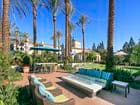 View of outdoor seating and a fire pit at Las Flores Apartment Homes in Rancho Santa Margarita, CA.