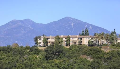 View of building exterior at Las Flores Apartment Homes in Rancho Santa Margarita, CA.