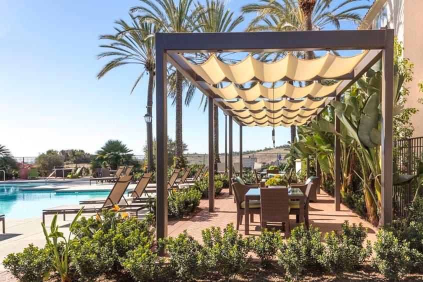 Exterior view of pool lounge area at Las Flores Apartment Homes in Rancho Santa Margarita, CA.