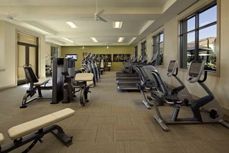 Interior view of fitness center at Amalfi Apartment Homes in Tustin, CA.