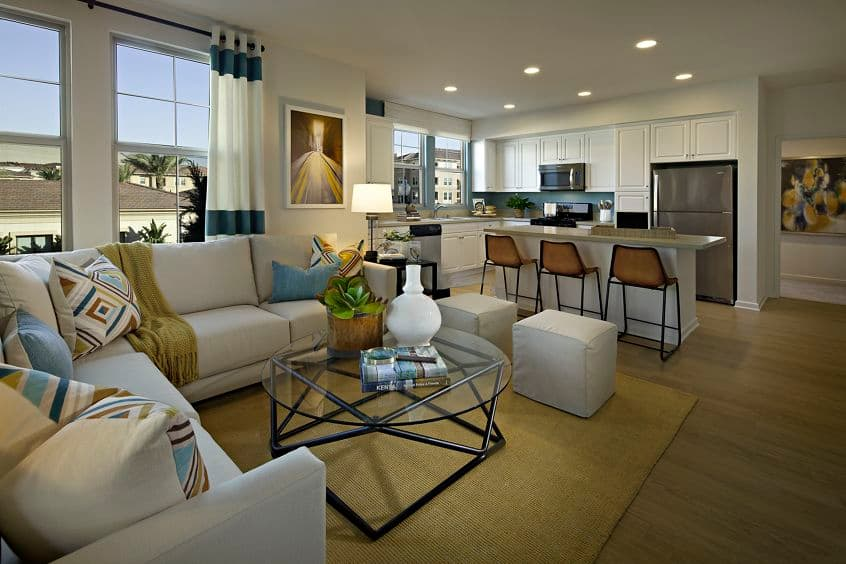 Interior view of living room and kitchen at Amalfi Apartment Homes in Tustin, CA.