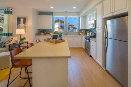 Interior view of kitchen at Amalfi Apartment Homes in Tustin, CA.