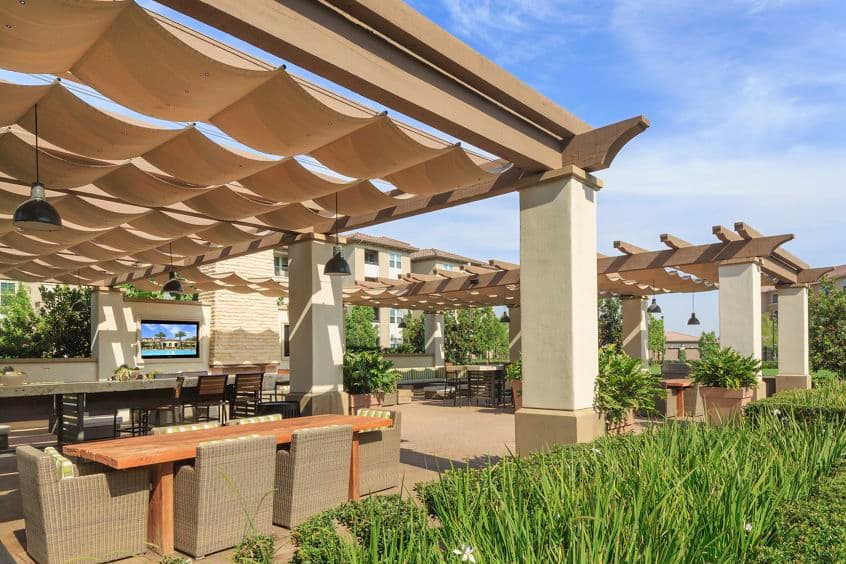 Exterior view of outdoor patio at Amalfi Apartment Homes in Tustin, CA.