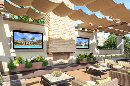Exterior view of outdoor patio and lounge area at Amalfi Apartment Homes in Tustin, CA.