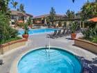 View of pool and spa at Rancho Alisal Apartment Homes in Tustin, CA.