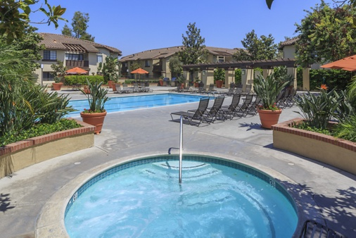 View of pool and spa at Rancho Alisal Apartment Homes in Tustin, CA.
