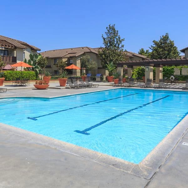 View of pool at Rancho Alisal Apartment Homes in Tustin, CA.