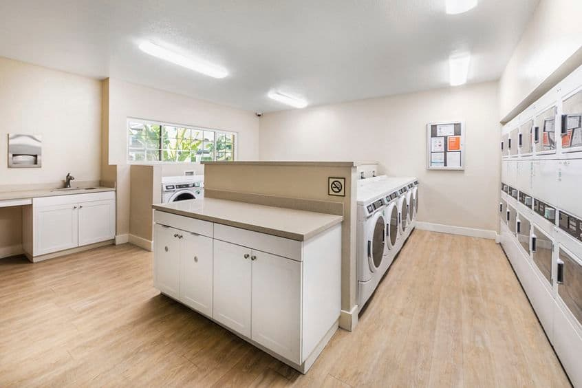 Interior view of laundry room at Rancho Alisal Apartment Homes in Tustin, CA.