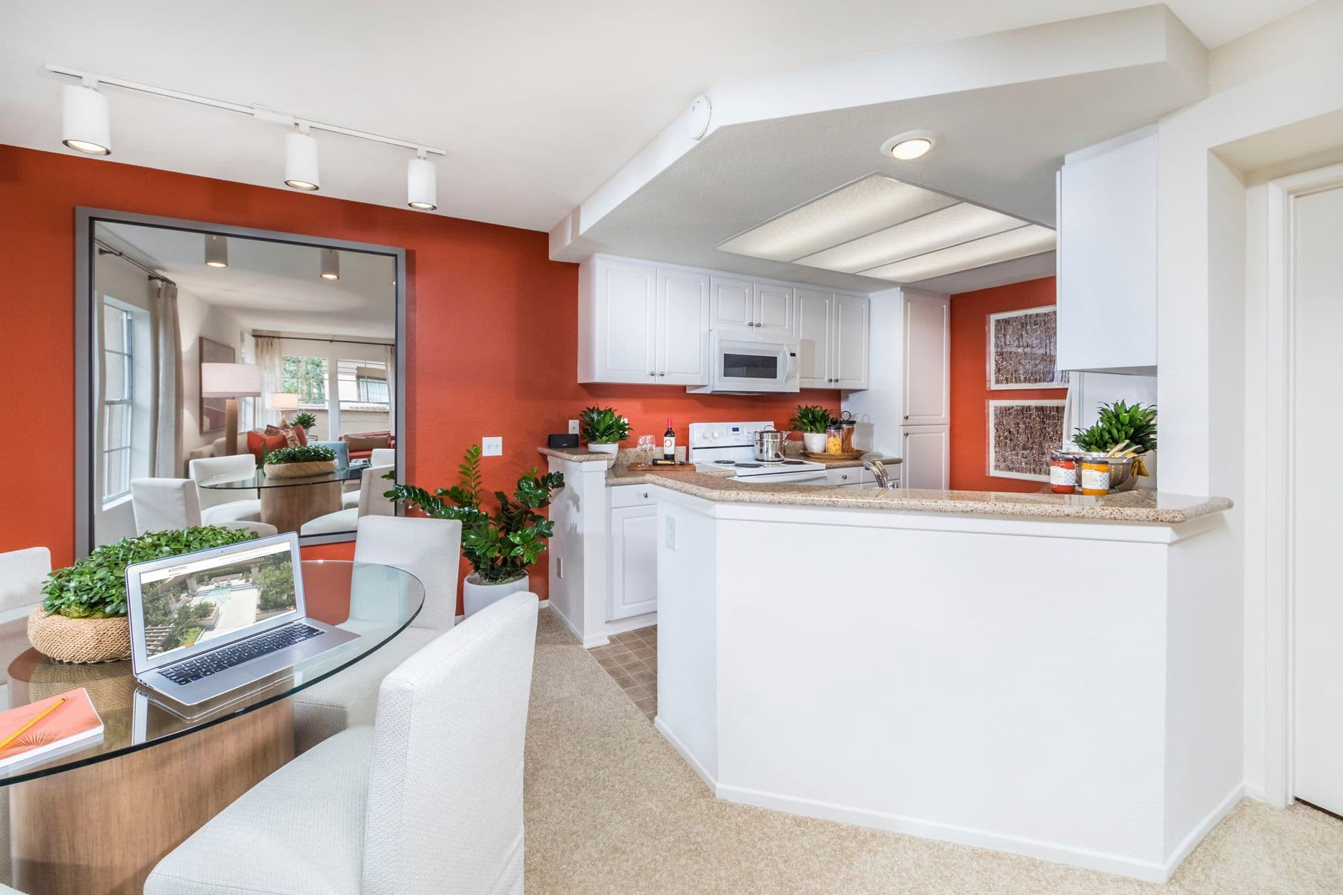 Interior view of kitchen and dining room at Rancho Maderas Apartment Homes in Tustin, CA.