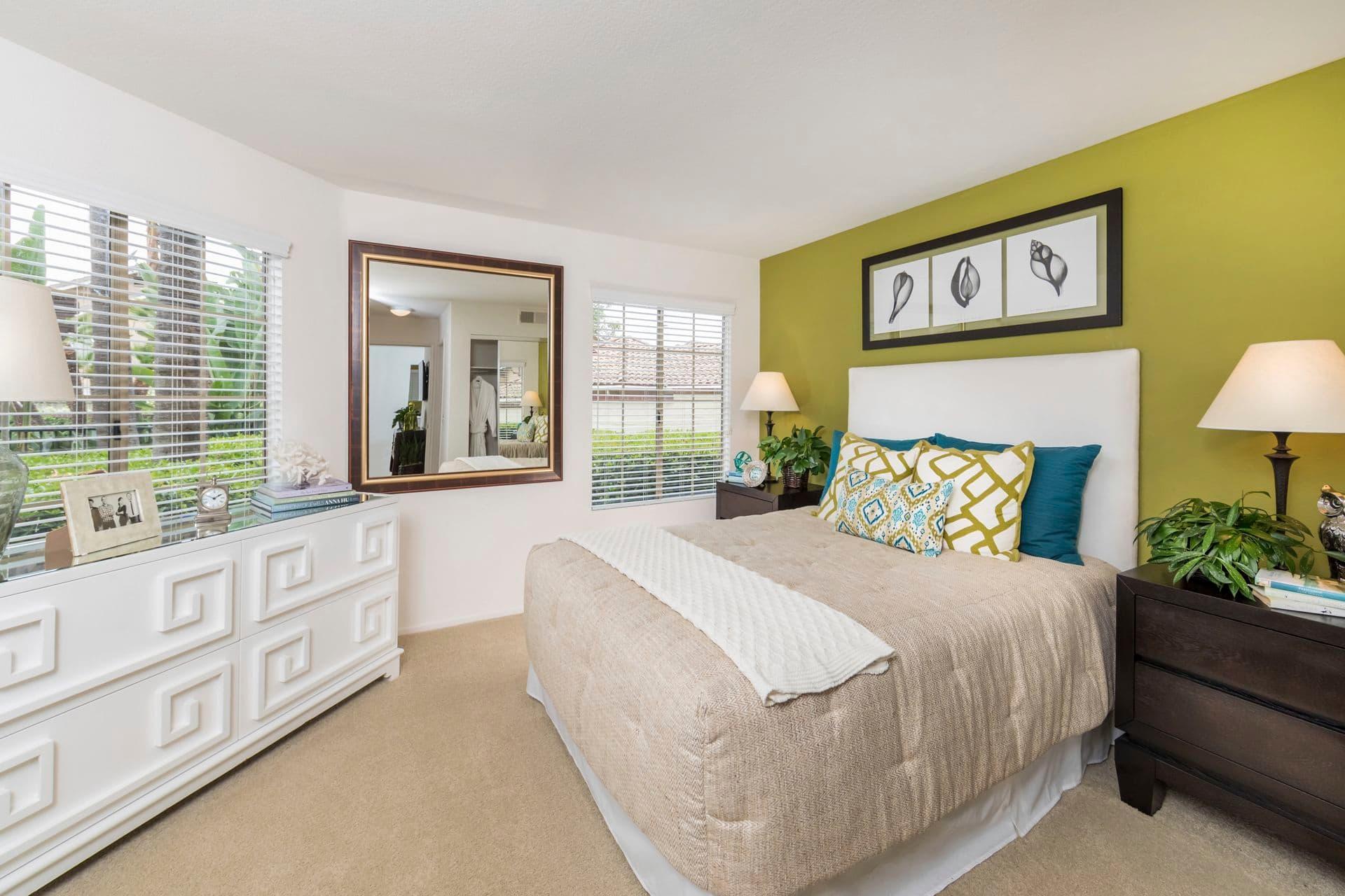 Interior view of bedroom at Rancho Mariposa Apartment Homes in Tustin, CA.