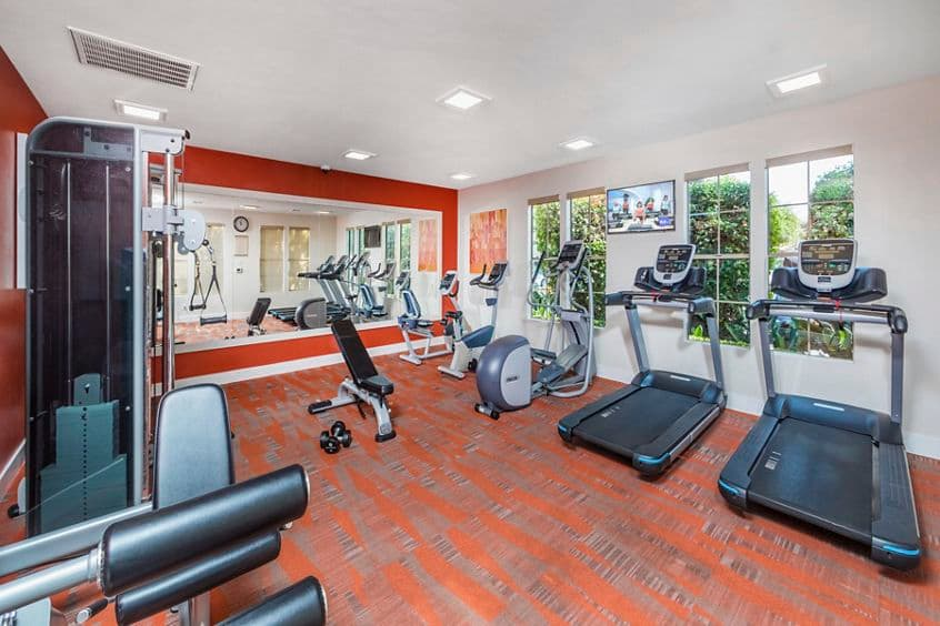 Interior view of fitness center at Rancho Mariposa Apartment Homes in Tustin, CA.
