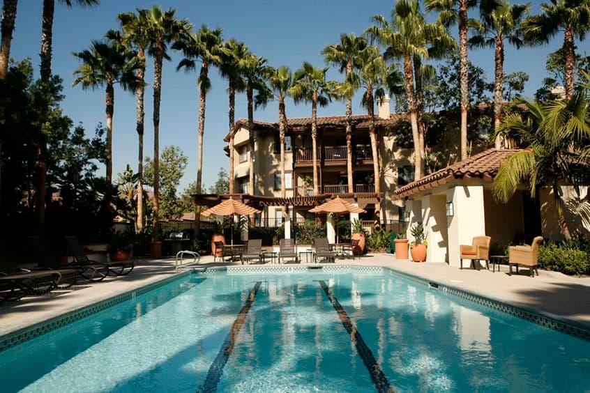 View of pool at Rancho Mariposa Apartment Homes in Tustin, CA.