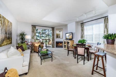 Interior view of living room and dining room at Rancho Monterey Apartment Homes in Tustin, CA.