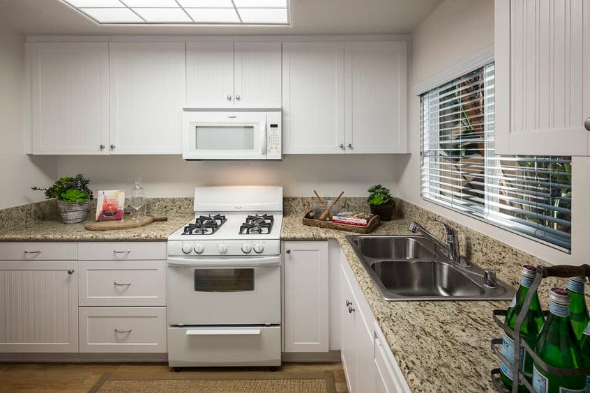 Interior view of kitchen at Rancho Santa Fe Apartment Homes in Tustin, CA.