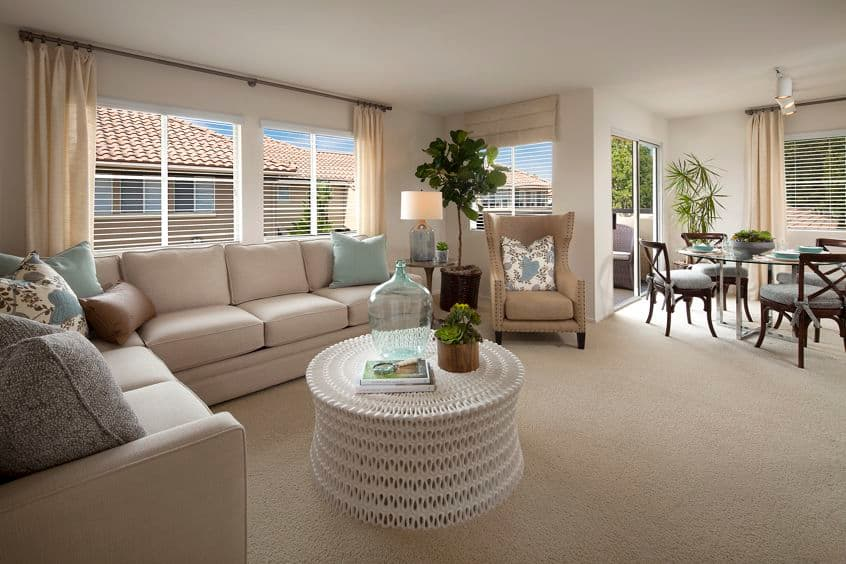 Interior view of dining room and living room at Rancho Santa Fe Apartment Homes in Tustin, CA.
