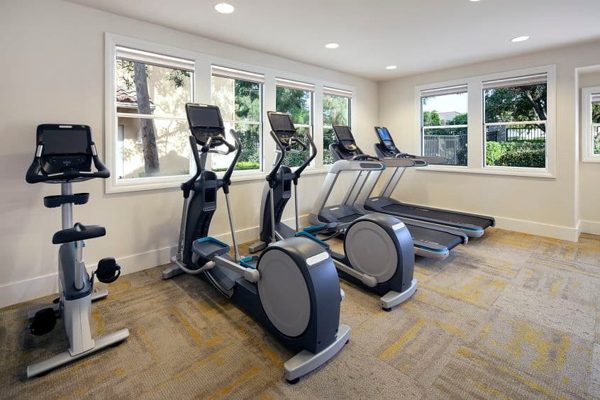 Interior view of fitness center at Rancho Santa Fe Apartment Homes in Tustin, CA.