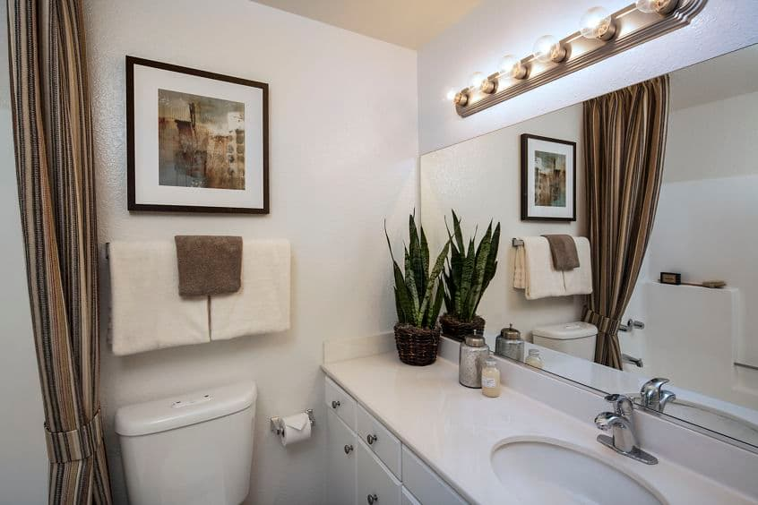 Interior view of bathroom at Rancho Tierra Apartment Homes in Tustin, CA.