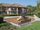 Exterior view of playground at Rancho Tierra Apartment Homes in Tustin, CA.