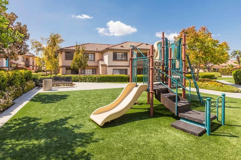 Exterior view of Tot Lot at  Rancho Tierra Apartment Homes in Tustin, CA.