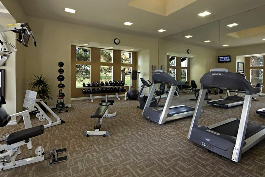 Interior view of fitness center at Sierra Vista Apartment Homes in Tustin, CA.