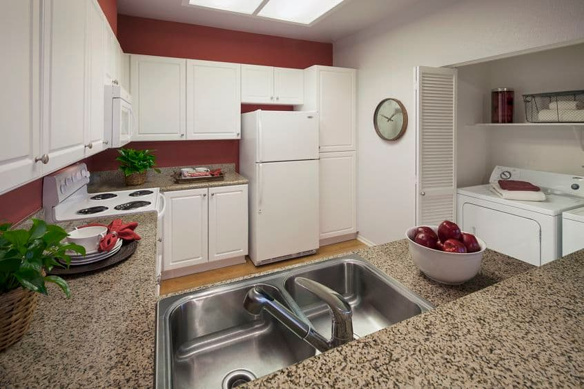 Interior view of kitchen at Sierra Vista Apartment Homes in Tustin, CA.