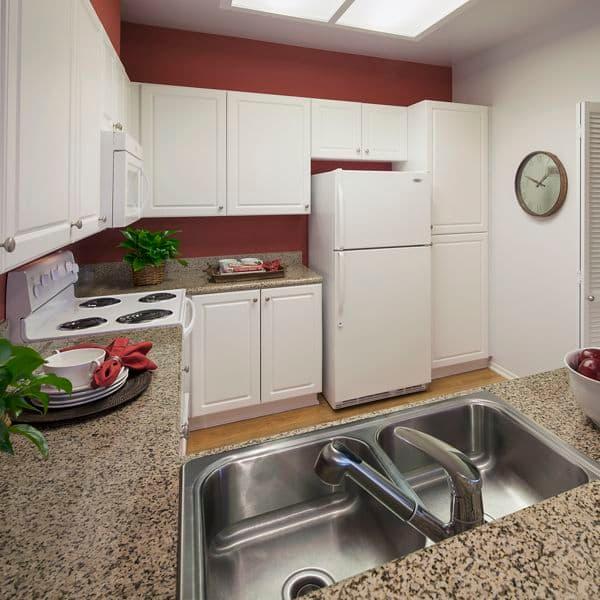 Interior view of kitchen at Sierra Vista Apartment Homes in Tustin, CA.