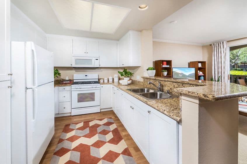 Interior view of kitchen at Arcadia at Stonecrest Apartment Homes in San Diego, CA.